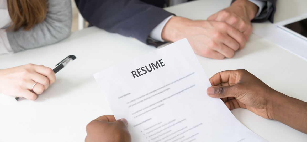 African American Applicant Holding Resume At Job Interview, Clos